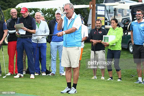 Joerg Wontorra reacts after he hits a tee shot during the 'RTL Wir helfen Kindern' Golf Charity 2015 tournament at Golf Club Oberberg on August 24...
