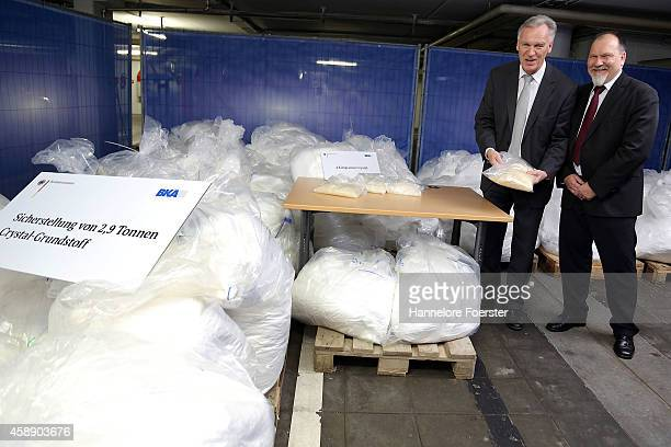 Joerg Ziercke president BKA and Peter Ko NPC present portions of crystal met and 29 tonnes of recentlyconfiscated chlorephedrin one of the main...