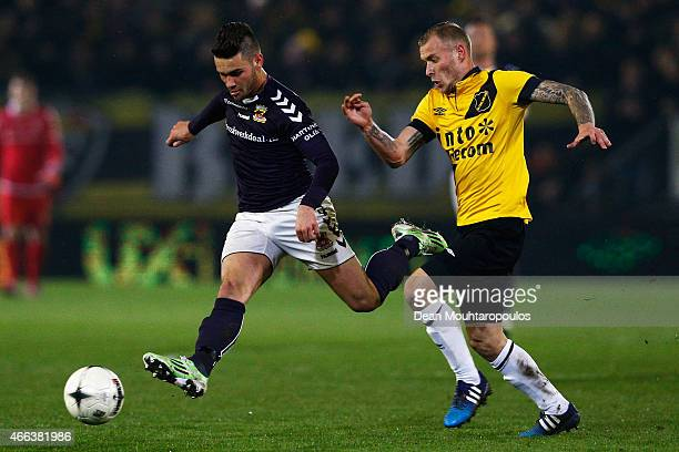 Joeri de Kamps of NAC and Alex Schalk of Go Ahead Eagles battle for the ball during the Dutch Eredivisie match between NAC Breda and Go Ahead Eagles...