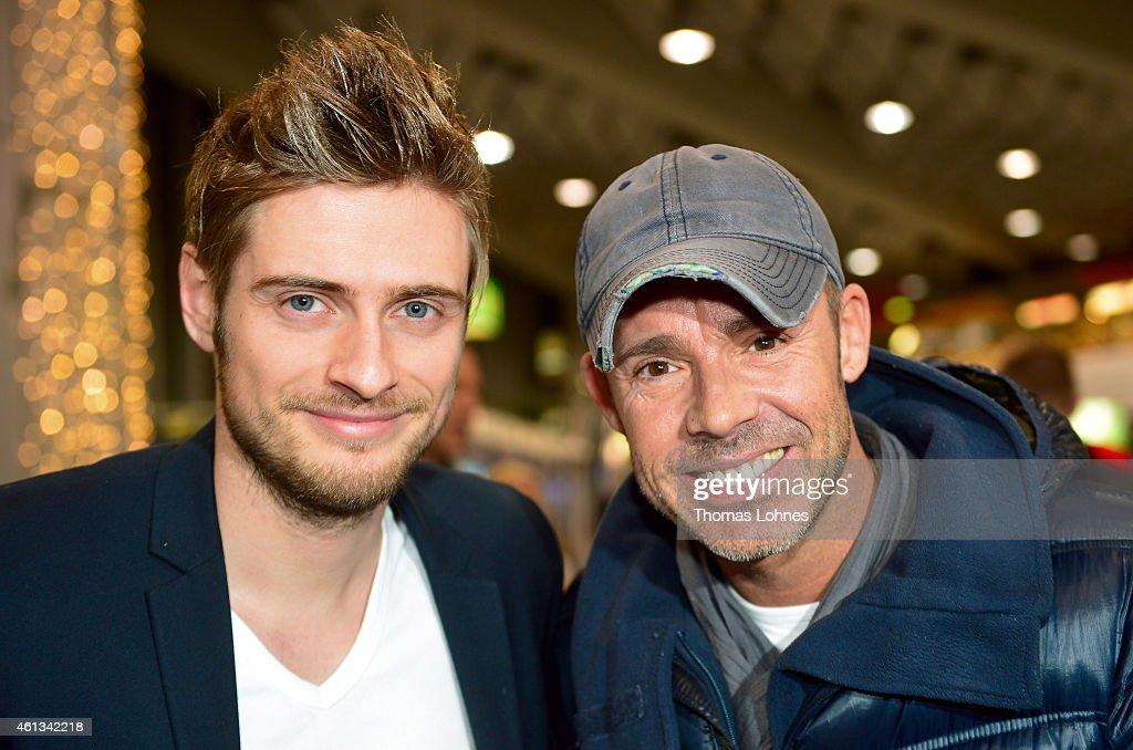 Joern Schloenvoigt and Benjamin Boyce pose before the flight to Australia as a participant in the 2015 RTLTVShow 'Dschungelcamp Ich bin ein Star Holt...