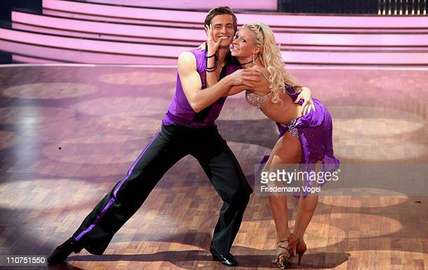 Joern Schloenvoigt and Helena Kaschurow perform during the 'Let's Dance' TV show at Coloneum on March 23 2011 in Cologne Germany
