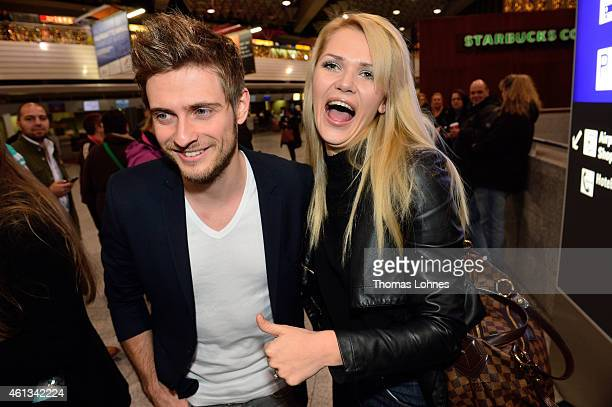 Joern Schloenvoigt and Sarah Kulka pose before the flight to Australia as a participant in the 2015 RTLTVShow 'Dschungelcamp Ich bin ein Star Holt...