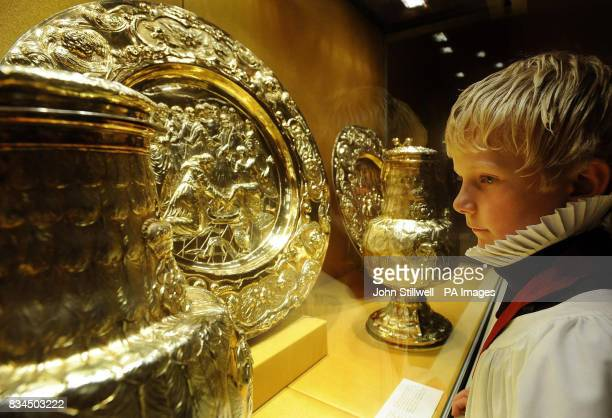 Joeseph Arnander a chorister at St Paul's Cathedral studies a glass display with some of the exhibits of the 'Treasures of the English Church Sacred...