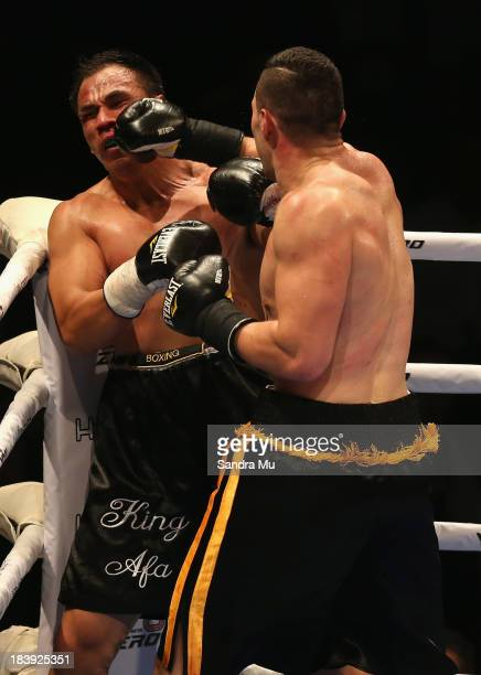 Joesph Parker punches Afa Tatupu during the New Zealand National Boxing Federation heavyweight title at the Trusts Arena on October 10 2013 in...