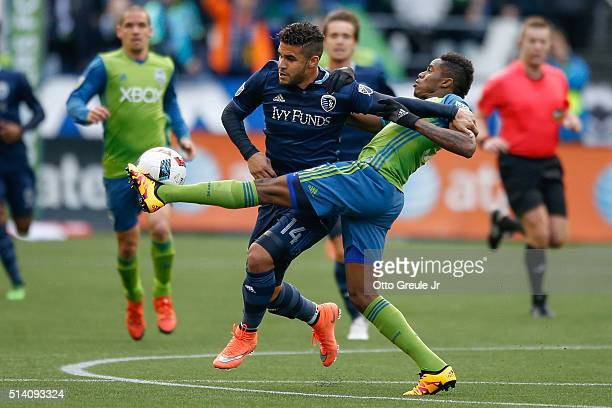 Joevin Jones of the Seattle Sounders FC battles Dom Dwyer of Sporting Kansas City at CenturyLink Field on March 6 2016 in Seattle Washington Sporting...