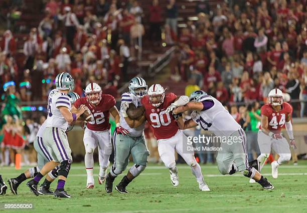 Joey Alfieri and Solomon Thomas of the Stanford Cardinal rush quarterback Jesse Ertz of the Kansas State Wildcats during an NCAA football game played...