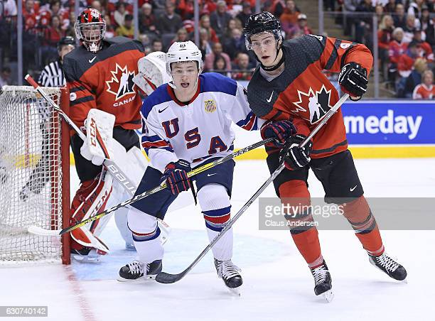Joey Anderson of Team USA skates against Philippe Myers of Team Canada during a preliminary round game in the 2017 IIHF World Junior Hockey...