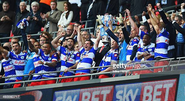 Joey Barton and Clint Hill of Queens Park Rangers lift the winners trophy following their sides victory during the Sky Bet Championship Playoff Final...
