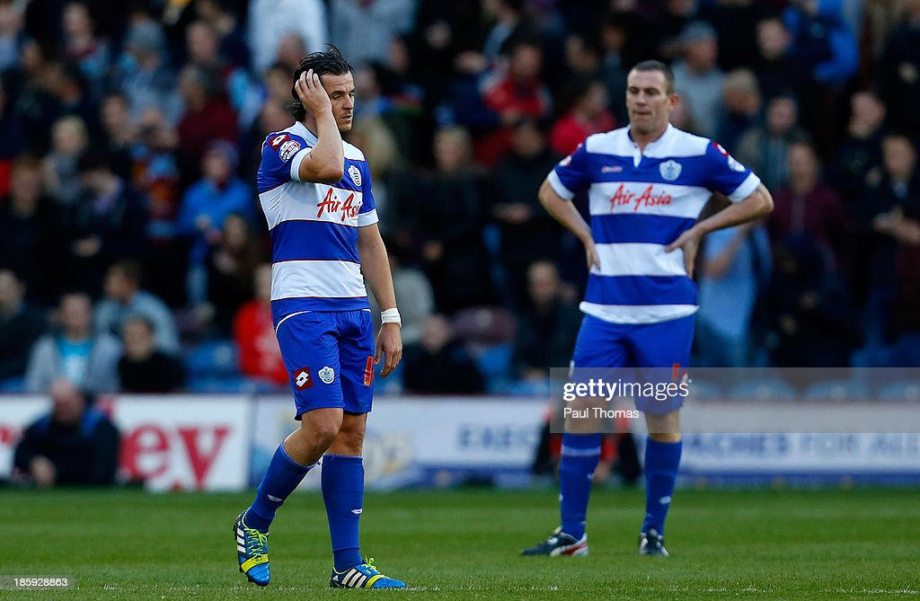 Joey Barton (L) and Richard Dunne of QPR react after Burnley score their second goal during the Sky Bet Championship match between Burnley and Queens Park Rangers at Turf Moor on October 26, 2013 in Burnley, England.