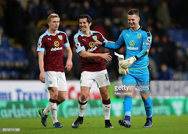 Joey Barton and Tom Heaton of Burnley celebrate victory after the Premier League match between Burnley and Southampton at Turf Moor on January 14...