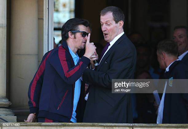 Joey Barton jokes with Burnley fan Alastair Campbell as Sky Bet Champions Burnley are presented with the Championship trophy at the Town Hall on May...