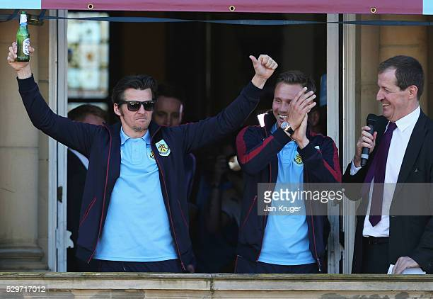 Joey Barton L0 salutes the crowd as team mate Matt Taylor and Burnley fan Alastair Campbell look on as Sky Bet Champions Burnley are presented with...