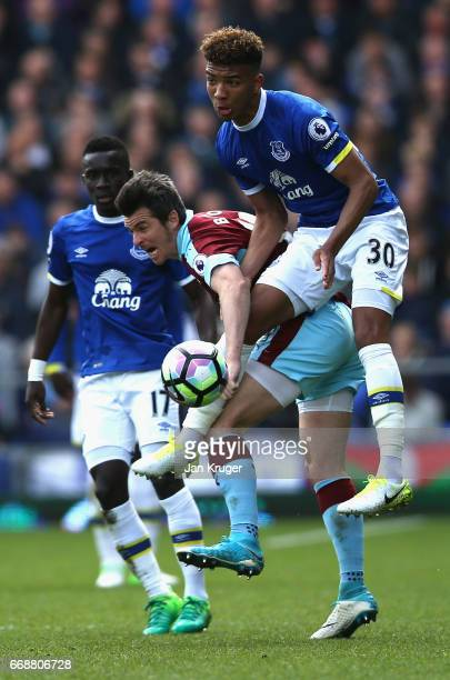 Joey Barton of Burnley and Mason Holgate of Everton battle for possession during the Premier League match between Everton and Burnley at Goodison...