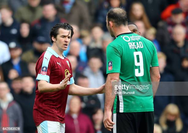Joey Barton of Burnley and Matt Rhead of Lincoln City exchange words during The Emirates FA Cup Fifth Round match between Burnley and Lincoln City at...