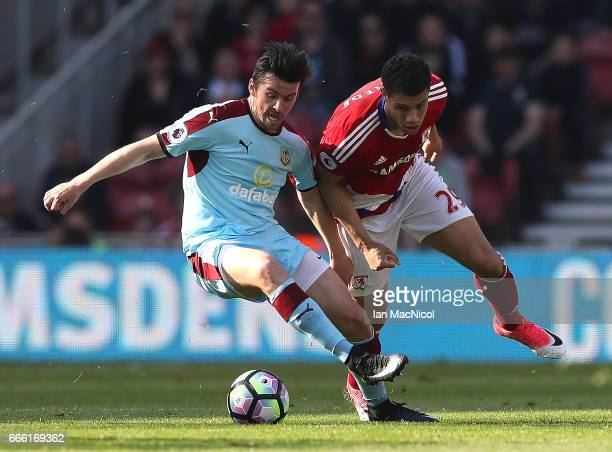 Joey Barton of Burnley and Rudy Gestede of Middlesbrough battle for possession during the Premier League match between Middlesbrough and Burnley at...