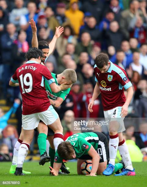 Joey Barton of Burnley and Terry Hawkridge of Lincoln City clash during The Emirates FA Cup Fifth Round match between Burnley and Lincoln City at...