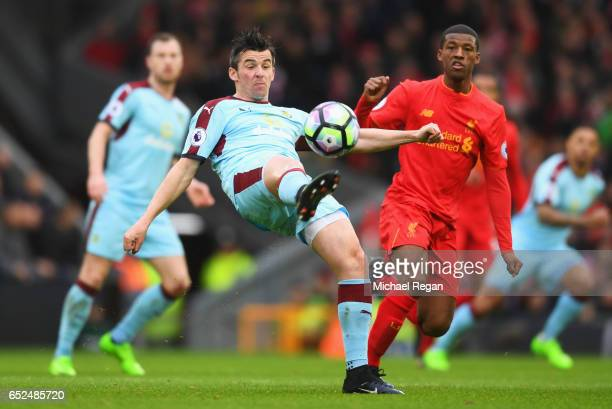 Joey Barton of Burnley beats Georginio Wijnaldum of Liverpool to the ball during the Premier League match between Liverpool and Burnley at Anfield on...
