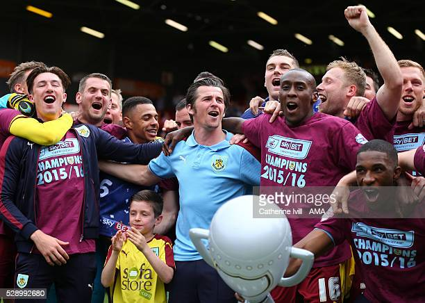 Joey Barton of Burnley celebrates promotion with his team mates after the Sky Bet Championship match between Charlton Athletic and Burnley at The...