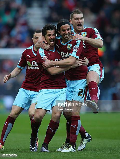 Joey Barton of Burnley celebrates with George Boyd and Sam Vokes after his deflected free kick goes in for the opening goal during the Sky Bet...