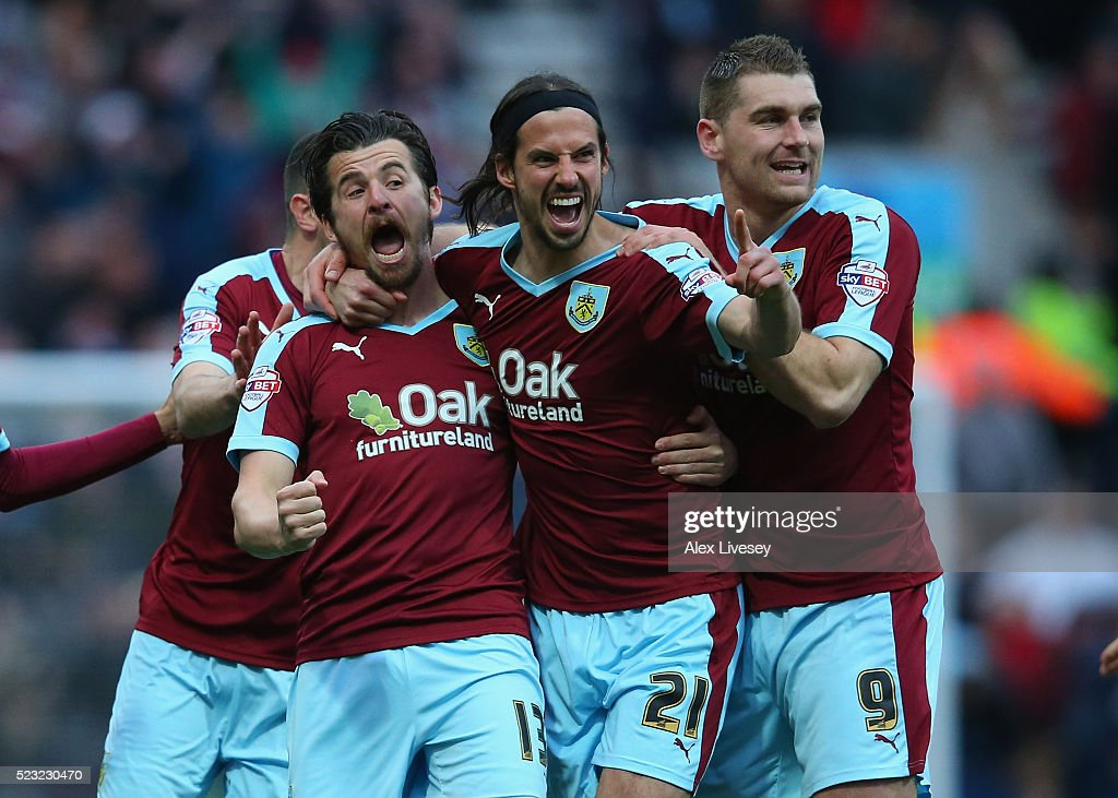 <a gi-track='captionPersonalityLinkClicked' href=/galleries/search?phrase=Joey+Barton&family=editorial&specificpeople=211284 ng-click='$event.stopPropagation()'>Joey Barton</a> of Burnley celebrates with team mates as his deflected free kick goes in for the opening goal during the Sky Bet Championship match between Preston North End and Burnley at Deepdale on April 22, 2016 in Preston, England.