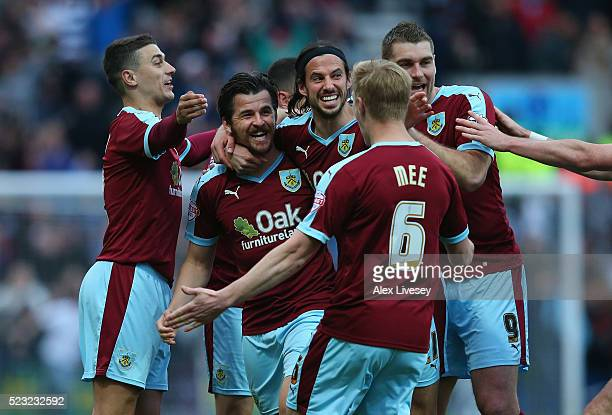 Joey Barton of Burnley celebrates with team mates as his deflected free kick goes in for the opening goal during the Sky Bet Championship match...