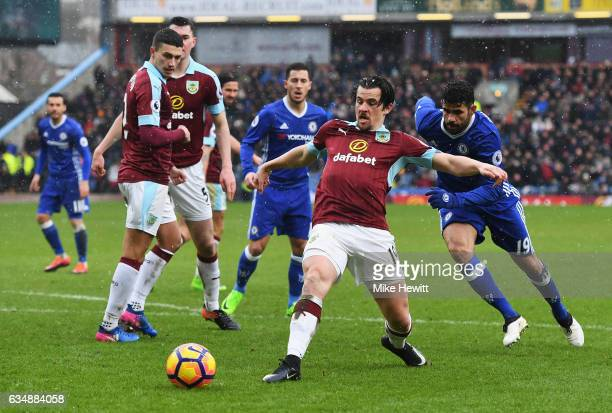 Joey Barton of Burnley is closed down by Diego Costa of Chelsea ring the Premier League match between Burnley and Chelsea at Turf Moor on February 12...