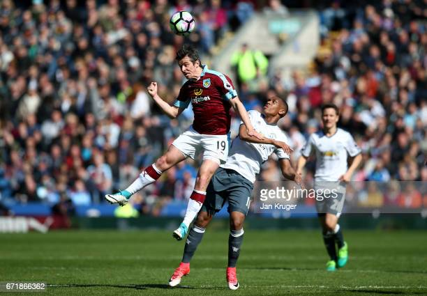 Joey Barton of Burnley jumps for the ball ahead of Anthony Martial of Manchester United during the Premier League match between Burnley and...