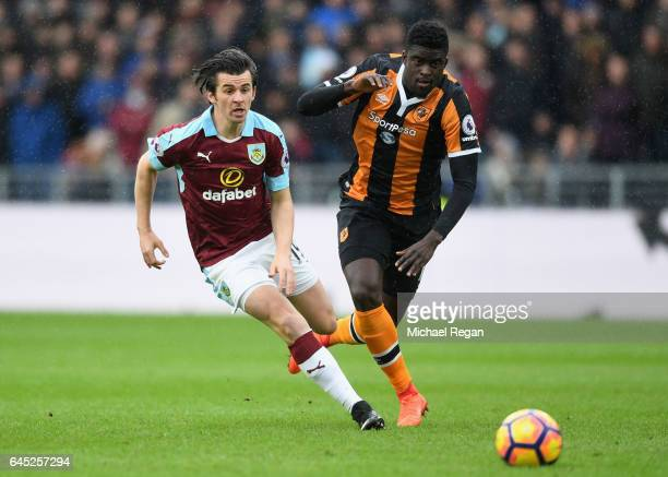 Joey Barton of Burnley puts pressure on Alfred N'Diaye of Hull City during the Premier League match between Hull City and Burnley at KCOM Stadium on...