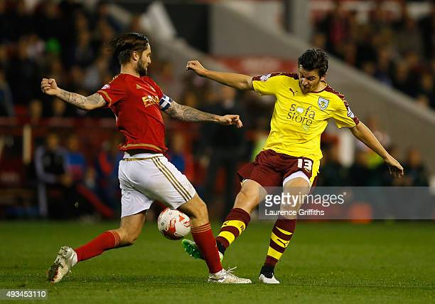 Joey Barton of Burnley tackles Henri Lansbury of Nottingham Forest during the Sky Bet Championship match between Nottingham Forest and Burnley at...