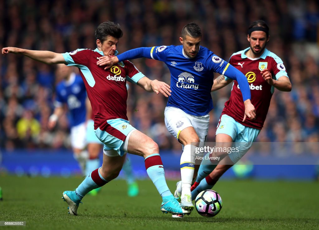 Joey Barton of Burnley tackles Kevin Mirallas of Everton during the Premier League match between Everton and Burnley at Goodison Park on April 15, 2017 in Liverpool, England.