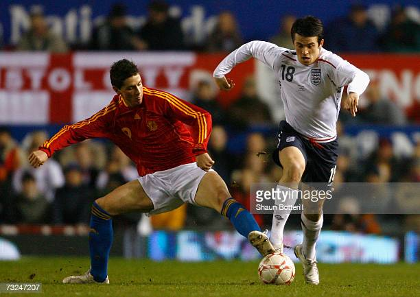 Joey Barton of England is challenged by Fernando Torres of Spain during the International Friendly match between England and Spain at Old Trafford on...