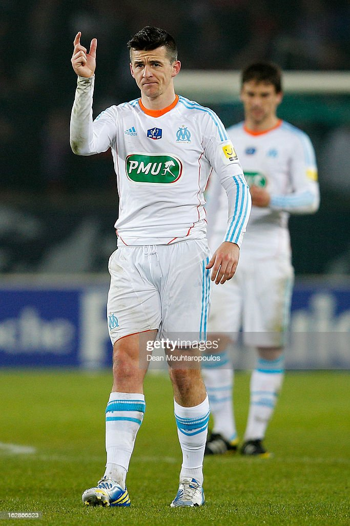 <a gi-track='captionPersonalityLinkClicked' href=/galleries/search?phrase=Joey+Barton&family=editorial&specificpeople=211284 ng-click='$event.stopPropagation()'>Joey Barton</a> of Marseille signals to a team mate during the French Cup match between Paris Saint-Germain FC and Marseille Olympic OM at Parc des Princes on February 27, 2013 in Paris, France.