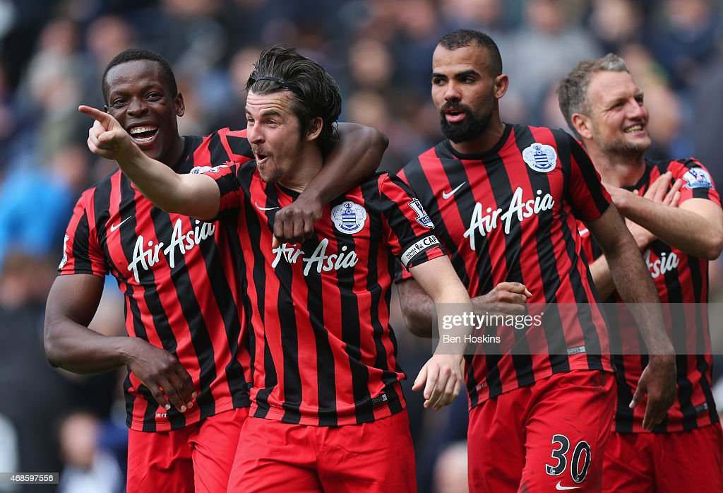 <a gi-track='captionPersonalityLinkClicked' href=/galleries/search?phrase=Joey+Barton&family=editorial&specificpeople=211284 ng-click='$event.stopPropagation()'>Joey Barton</a> of QPR (2L) celebrates scoring their fourth goal with team mates during the Barclays Premier league match West Bromwich Albion and Queens Park Rangers at The Hawthorns on April 4, 2015 in West Bromwich, England.