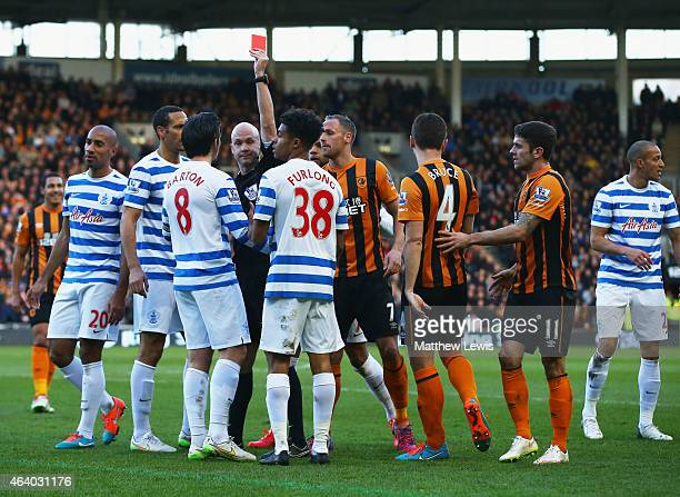 Joey Barton of QPR is shown a red card and is sent off by referee Anthony Taylor during the Barclays Premier League match between Hull City and...