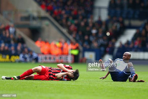 Joey Barton of QPR lies injured on the pitch after a foul from Youssuf Mulumbu of West Brom during the Barclays Premier league match West Bromwich...