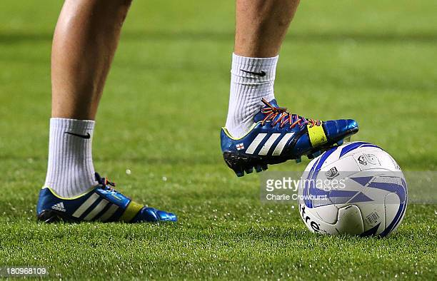 Joey Barton of QPR wears rainbow coloured shoe laces during the Sky Bet Championship match between Queens Park Rangers and Brighton Hove Albion at...