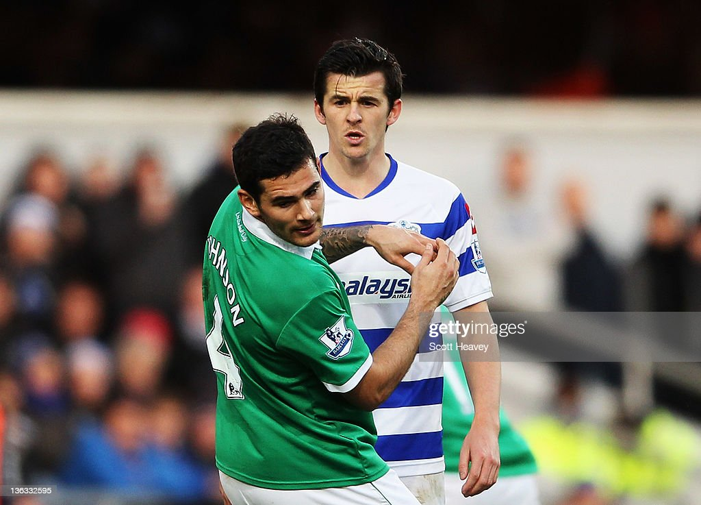 <a gi-track='captionPersonalityLinkClicked' href=/galleries/search?phrase=Joey+Barton&family=editorial&specificpeople=211284 ng-click='$event.stopPropagation()'>Joey Barton</a> (R) of Queens Park Rangers confronts Bradley Johnson (L) of Norwich City and is sent off during the Barclays Premier League match between Queens Park Rangers and Norwich City at Loftus Road on January 2, 2012 in London, England.