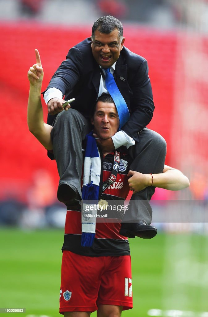 Joey Barton of Queens Park Rangers lifts Queens Park Rangers Chairman Tony Fernandes onto his shoulders following their victory during the Sky Bet Championship Playoff Final between Derby County and Queens Park Rangers at Wembley Stadium on May 24, 2014 in London, England.