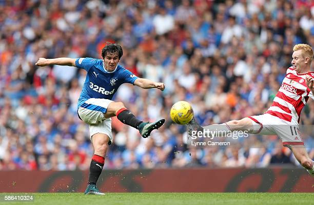 Joey Barton of Rangers has a shot on goal as Alister Crawford of Hamilton Academical tries to close him down during the Ladbrokes Scottish...