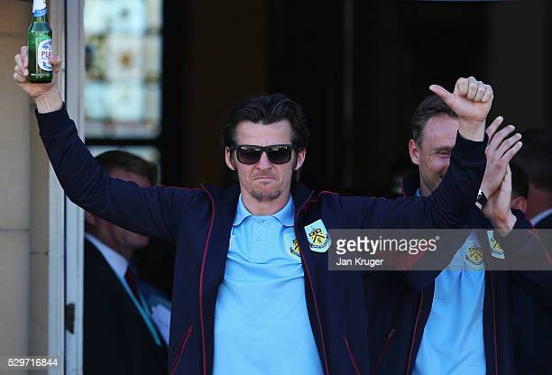 Joey Barton salutes the crowd as Sky Bet Champions Burnley are presented with the Championship trophy at the Town Hall on May 9 2016 in Burnley...