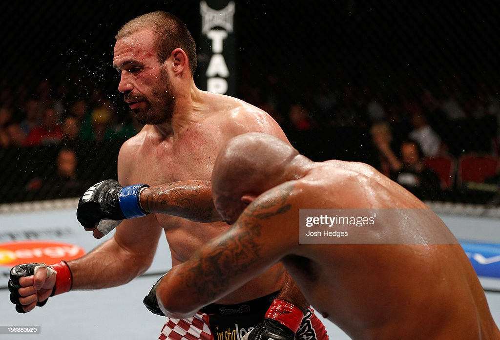 Joey Beltran punches Igor Pokrajac during their light heavyweight fight at the UFC on FX event on December 15, 2012 at Gold Coast Convention and Exhibition Centre in Gold Coast, Australia.