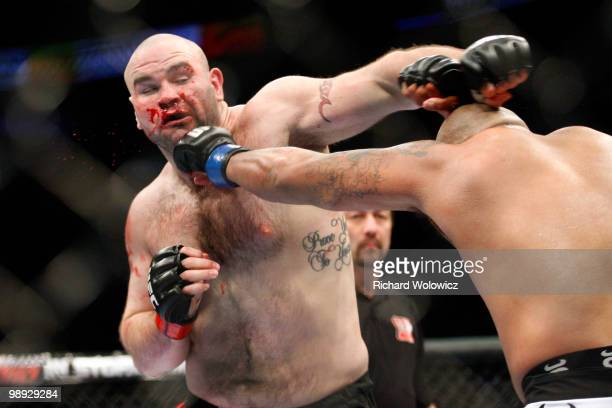 Joey Beltran punches Tim Hague in their heavyweight bout at UFC 113 at Bell Centre on May 8 2010 in Montreal Quebec Canada