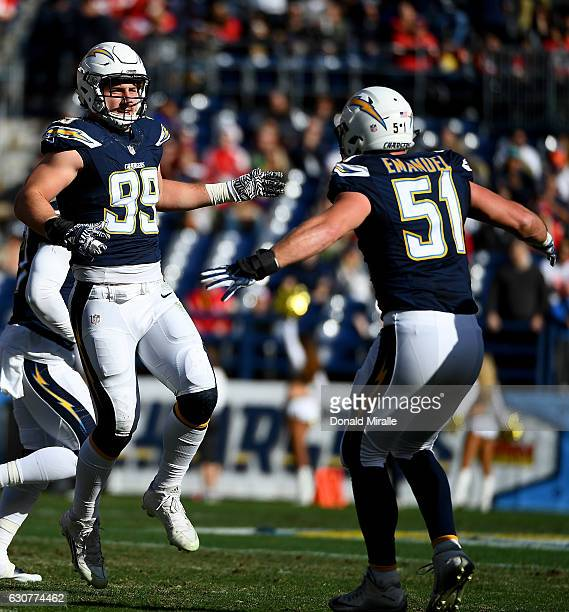 Joey Bosa and Kyle Emanuel of the San Diego Chargers react after Bosa sacked Alex Smith of the Kansas City Chiefs during the first half of a game at...
