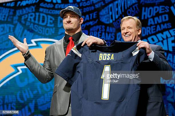 Joey Bosa of Ohio State holds up a jersey with NFL Commissioner Roger Goodell after being picked overall by the San Diego Chargers during the first...