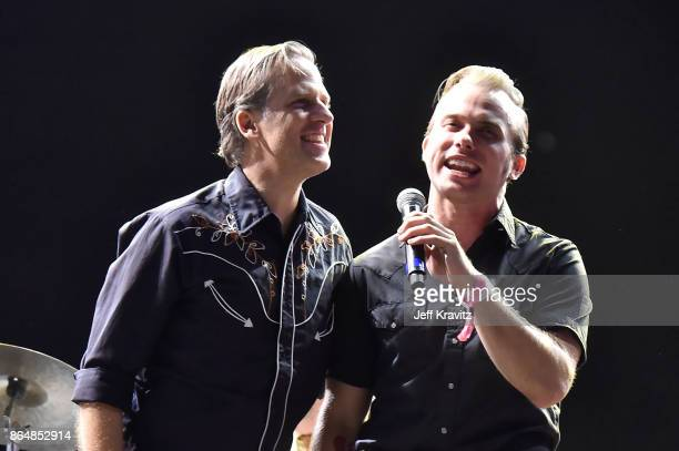 Joey Burns of Calexico and Chase Simpson of The Shelters perform during Soul Bugs Superjam The DapKings play The Beatles at Piestewa Stage during day...
