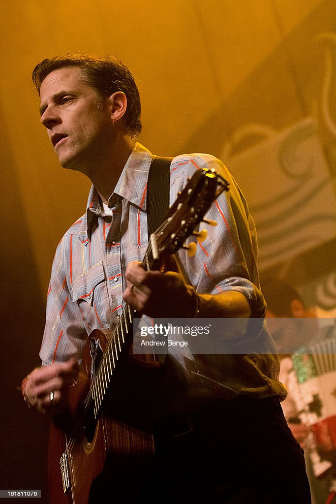 Joey Burns of Calexico perform on stage at HMV Ritz on February 16, 2013 in Manchester, England.