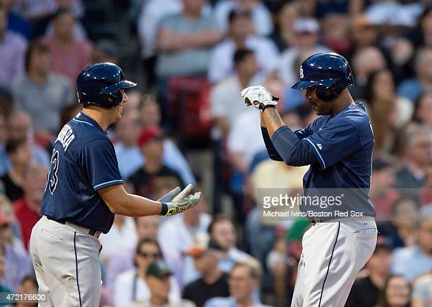Joey Butler of the Tampa Bay Rays is congratulated by Asdrubal Cabrera after hitting a tworun home run against the Boston Red Sox during the second...