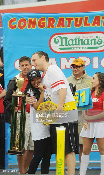 Joey Chestnut and his fiance Neslie Ricasa at the 2014 Nathan's Famous 4th July International Hot Dog Eating Contest at Coney Island on July 4 2014...