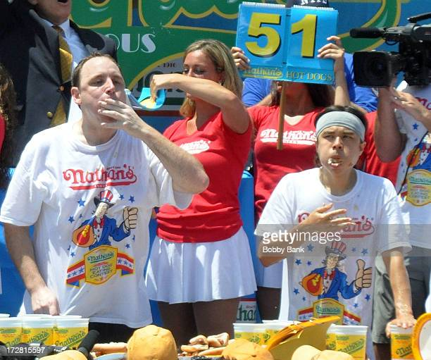 Joey Chestnut and Matt Stonie compete in the 2013 Nathan's Famous Hot Dog Eating Contest at Coney Island on July 4 2013 in New York City