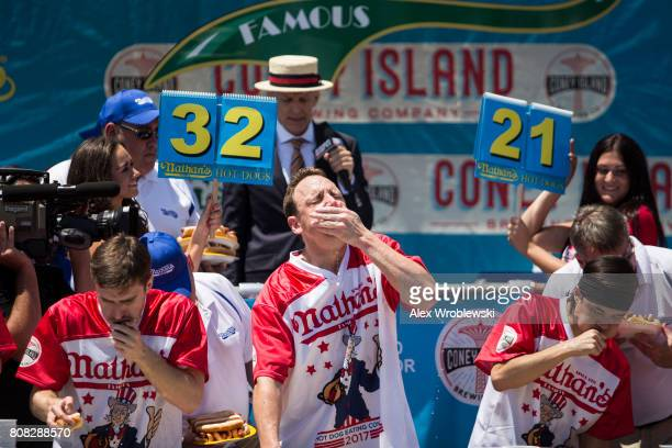 Joey Chestnut and Matt Stonie compete in the 2017 Nathan's Famous International Hot Dog Eating Contest at Coney Island on July 4 2017 in the Brooklyn...